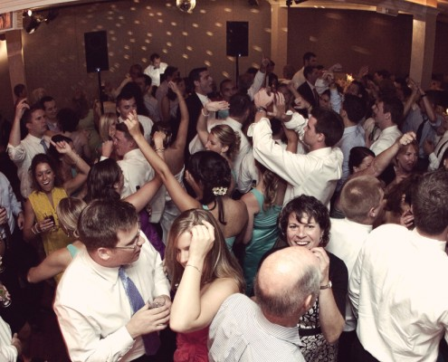 Guests pack the dance floor for a wedding reception